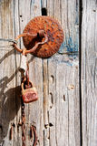 Old rusty wooden door with padlock Stock Image