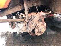 Old rusty worn brake discs, pads of a truck, car. Car suspension repair. Replacing wheel.  stock photography
