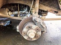 Old rusty worn brake discs, pads of a truck, car. Car suspension repair. Replacing wheel stock photos