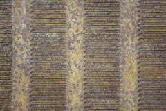 Old rusty yellow gray brown metal grille ventilation louvers. rough surface texture royalty free stock images