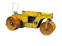 Old rusty yellow road roller isolated over white Stock Image