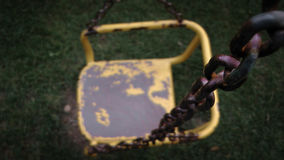 Old and Rusty Yellow Swing anc Chain Royalty Free Stock Photos