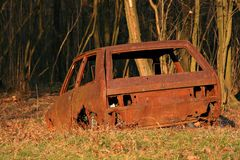 Old rusty Yugo decomposing stock photo