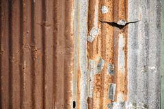 Old rusty zinc corrugated metal wall. Stock Photo
