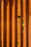 Old rusty of zinc sheet fence is grunge background. stock photos