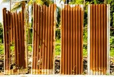 Old rusty of zinc sheet  fence is grunge  background. Stock Photo