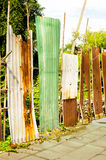Old rusty of zinc sheet  fence is grunge  background. Old rusty of zinc sheet  fence is grunge  background around the home Royalty Free Stock Image