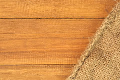 Old sack on top of wooden plank Stock Images