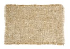 Old sackcloth. Piece of old handmade rough sackcloth on white stock photo