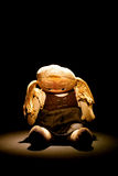 Old sad cloth doll with spot light Royalty Free Stock Photos