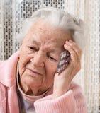 Old sad woman holding pills Royalty Free Stock Photos
