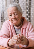 Old sad woman at home Royalty Free Stock Images