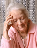 Old sad woman Stock Image