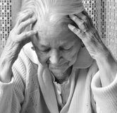 Old sad woman Stock Images