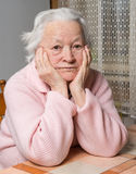 Old sad woman Stock Photo