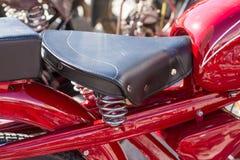 Old saddle type seat. Old motorbike saddle type seat with springs stock photo