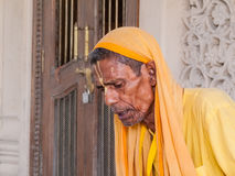 Old sadhu reading scriptures Stock Image