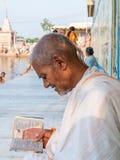 Old sadhu reading Stock Photography