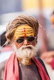 Old sadhu with sunglasses Stock Photos