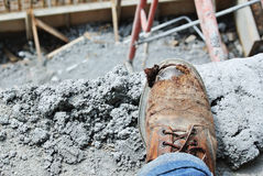 Old safety boots with construction site at background Stock Photography