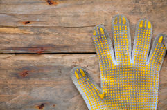 Old safety gloves on wooden background, Gloves on dirty works Royalty Free Stock Photo
