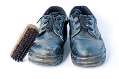 Old Safety shoes and brush Royalty Free Stock Image