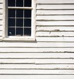 Old sagging window. Graphic compostion of a window on an old wooden building royalty free stock images