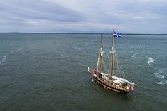 Old sail boat approching Port of Montreal on the St-Lawrence River stock photo