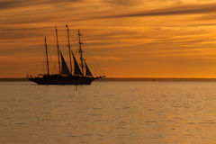 Old sail ship silhouette in sunset Royalty Free Stock Photos