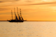 Old sail ship silhouette in sunset Stock Images