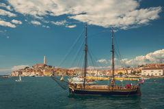 Old sailboat in the bay of old town Rovinj in Croatia Stock Image