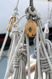 Old sailboat blocks. Detail of wooden blocks with ropes on a classical sailboat Stock Photos