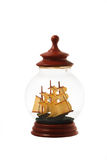 Old sailboat in glass bottle or jar isolated over white backgrou Stock Images