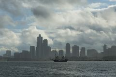 Old sailboat on Lake Michigan and Chicago skyline. Old sailboat on Lake Michigan in front of marina and Chicago skyline during cloudy day stock photos