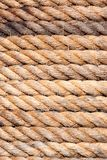 Old sailboat rope background texture. Portrait version. Close up shoot of an old sailboat rope for background and texture purposes. Portrait version stock image