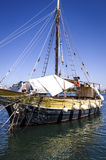 Old sailboat still in the harbor. Old sailboat still in the port of Ischia, Italy Stock Photos