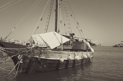 Old sailboat still in the harbor. Old sailboat still in the port of Ischia, Italy stock photography