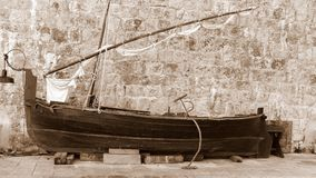 Old sailing boat. Is on the waterfront in Dubrovnik and waiting restoration. This is verry interesting for tourists, because is sailboat from 19. century (1933 royalty free stock image