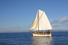 Old sailing boat. Cruising under sails in very nice sunny weather Stock Images