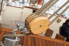 Old sailing boat detail. pulleys and ropes royalty free stock photo