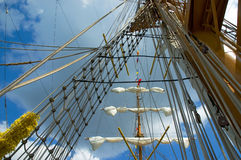 Old sailing ship. Sail and mast of old ship on a blue sky background Stock Photography