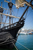 Old sailing ship. An old sailing ship in port on the yachts background royalty free stock photo