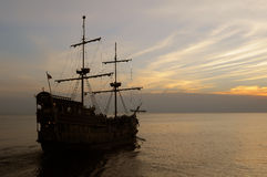 Old sailing ship at dusk Stock Photos