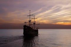 Old sailing ship at dusk stock images