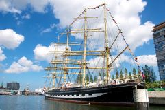 Old sailing ship in harbor Stock Images