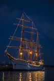 Old Sailing Ship Lit up in Midnight Blue Sky Stock Photos
