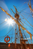 Old sailing ship mast. On blue sky background and sun rays Royalty Free Stock Photography