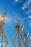 Old sailing ship mast. On blue sky background and sun rays Royalty Free Stock Photos