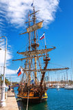 Old sailing ship mast yacht with Russian flag in Barcelona harbor marine Stock Photo