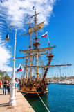 Old sailing ship mast yacht with Russian flag in Barcelona harbor marine Royalty Free Stock Photo